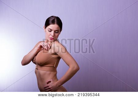 Woman Wearing A Compressing Bra