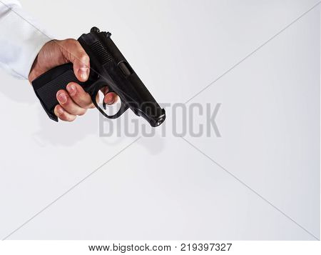 Man hand with a gun isolated on white background.