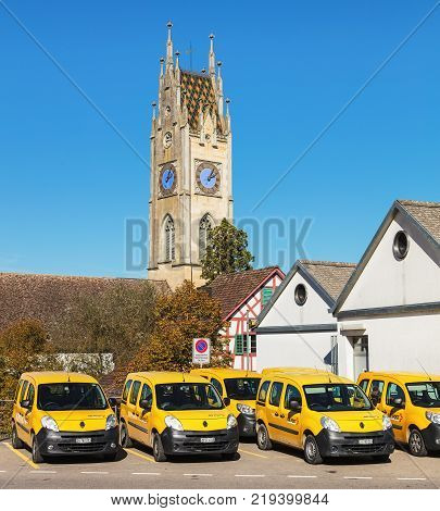 Andelfingen, Switzerland - 17 October, 2017: parked cars of Swiss Post. Swiss Post is the national postal service of Switzerland, being a public company owned by the Swiss Confederation.
