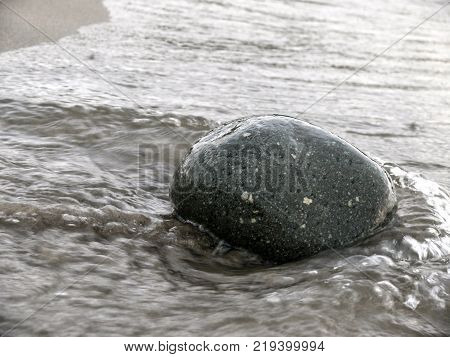 Lonely Pebble In Sand