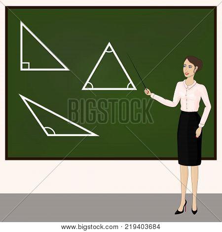 Young school teacher. The teacher leads the lesson.