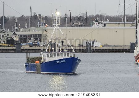 Fairhaven Massachusetts USA - December 22 2017: Lobster boat Direction eases its way toward Fairhaven dock