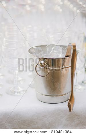 Cold ice in a bucket. Ice Bucket with tranparent cubes of ice.