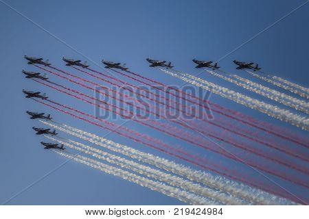 Doha, Qatar - December 18, 2017: Perform of Reactive jet plane on Qatar National Day parade on the Corniche street, Doha, Qatar
