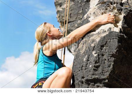 Rock Climbing Blond Woman On Rope Sunny