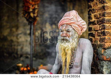 KATHMANDU, NEPAL - OCTOBER 21, 2015 : Portrait of Shaiva sadhu with traditional long beard in Pashupatinath Temple