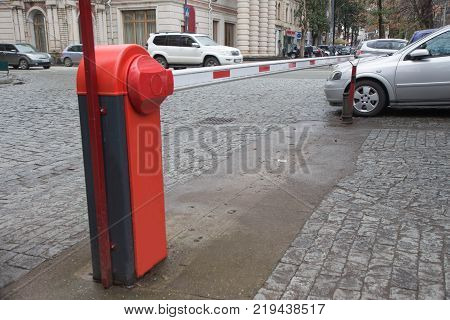 Barrier Gate Automatic system for security. Barrier on car parking building hall with colomn automatic entry system