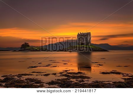 Sunset over Castle Stalker, Highlands, Scotland, United Kingdom. Long exposure and hdr processed.