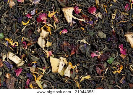 Invigorating Green Tea pineapple pieces, rosehip, slices of apple, cherry, strawberry, marigold petals and roses.