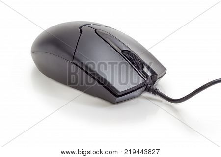 Modern black typical cabled optical computer mouse with two buttons and a scroll wheel on a matte surface closeup on a white background