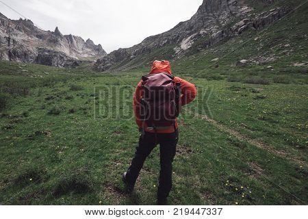 female hiker hiking on high altitude mountain