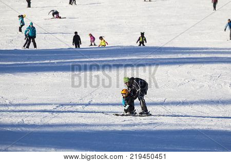 January 1 2017 . Ski park Kubinska Hola Slovakia. District Dolny Kubin near the border with Poland. New Year. Bright frosty holiday. People skiing parents teach children to ski. Concept of sport family rest healthy lifestyle.