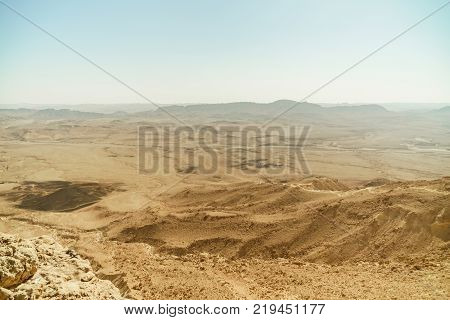 Israel desert and crater mitzpe ramon. Famous geological place for tourism. Golden sand and mountains