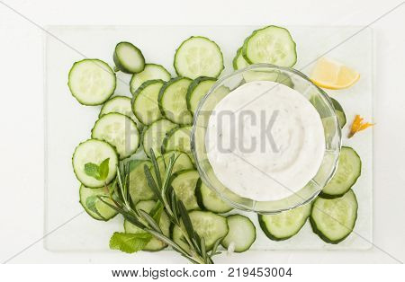 Drink Of Chopped Cucumber And Mint On White Background