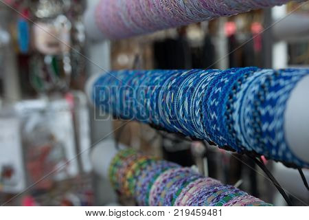 Braided leather bracelets with beads in the store.