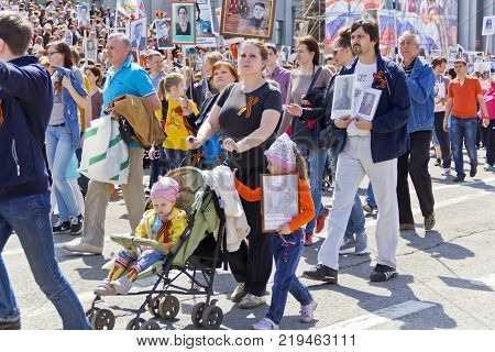 SAMARA RUSSIA - MAY 9 2017:  people in Immortal Regiment on annual Victory Day May 9 2017 in Samara Russia