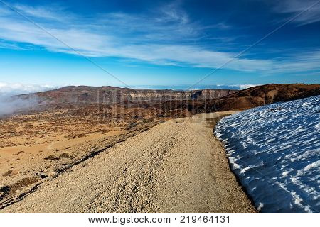 Teide National Park, Tenerife, Canary Islands - Gravel footpath of the Montana Blanca volcanic ascent trail. This scenic hiking path leads up to the 3718 m Teide Peak, the highest peak in Spain.