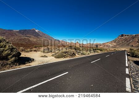 Stretch of road going through Teide National Park, Tenerife, leading to Montana Blanca. The landscape throughout this park is very rich and colourful due to the central Teide volcano.