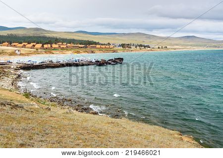 View of Pier with ships and beach in Khuzhir Village on Olkhon Island Siberia Russia