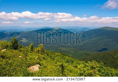 mountainous landscape on fine summer day. some clouds in a distance on a blue sky