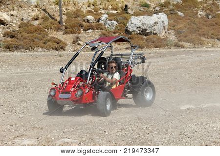 Sport / A young man controls a buggy