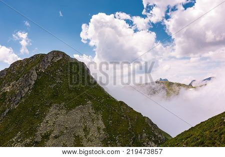 mountain ridge on a cloudy day. beautiful nature summer scenery in Fagaras mountains Romania. concept of outdoor activity in any weather condition. lovely travel background