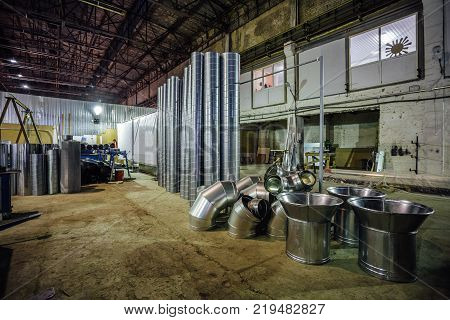 Steel pipes and other parts for construction of ducts of industrial air condition system in the factory.