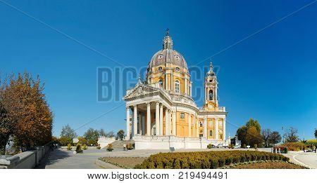 ITALY, TORINO, NOV. 11, 2011: View on beautiful white orange church Superga in italian Alps mountains. Italian Superga cathedral church. Famous Italian baroque architecture.