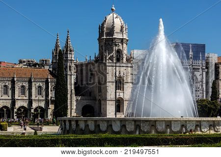 Lisbon Portugal August 6 2017: Empire Square fountain and the Jeronimos Monastery. The square commemorates the Portuguese Empire and was built for the Portuguese World Exhibition in 1940.