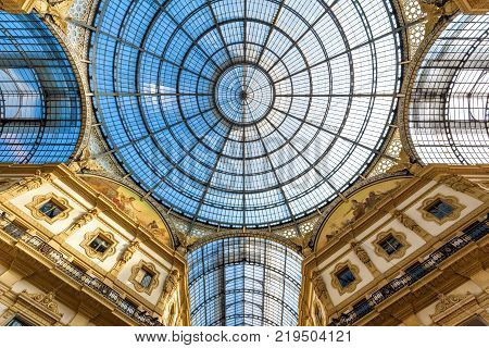 Milan, Italy - May 16, 2017: Glass dome of Galleria Vittorio Emanuele II in central Milan. This gallery is one of the world's oldest shopping malls and tourist attraction of Milan.