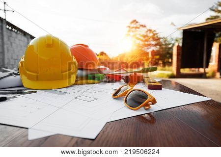 A desk of contractor engineers who are going to build a low cost home and save energy.