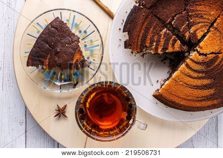 Pecan pie and tea top view, on white wooden background