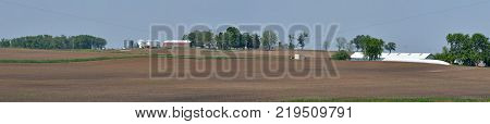 vast midwest farm land panorama rolling hills