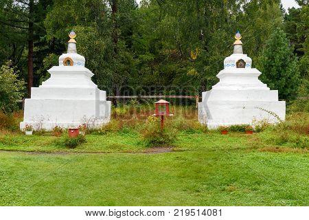 Buddhist stupa. Buddhist datsan Bodhidharma at the foot of Mundarga Mountain of Tunka range in Arshan. Buryatia. Russia