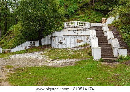 Old white concrete stairs in Arshan. Buryatia. Russia