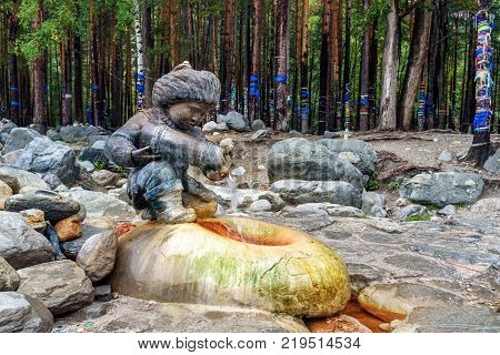 Source Of Mineral Water. Water Flows From Form Of Figures Of Boy With Jug. Arshan. Russia