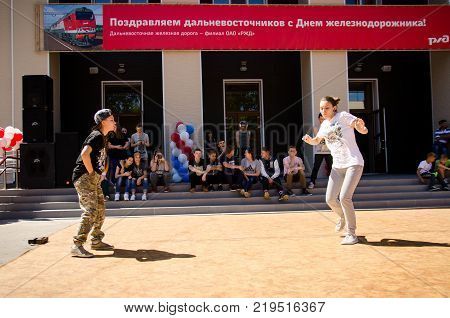 Komsomolsk-on-Amur Russia 1 August 2015. two girsl dances breakdance in the square with spectators