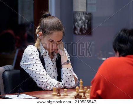 ST. PETERSBURG, RUSSIA - DECEMBER 4, 2017: Alina Kashlinskaya in the match against Oksana Gritsayeva during super finals of 67th Russian women's chess championship. Kashlinskaya won the match