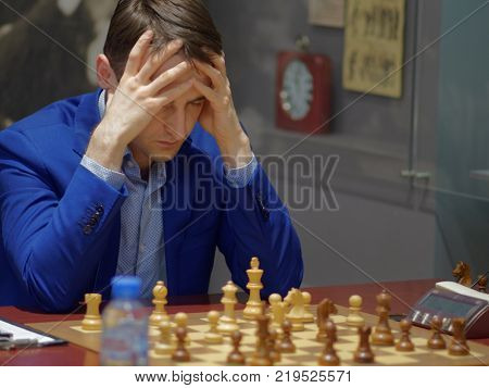 ST. PETERSBURG, RUSSIA - DECEMBER 4, 2017: Ernesto Inarkiev in the match against Sergey Volkov during super finals of 70th Russian men's chess championship. The match ended in a draw