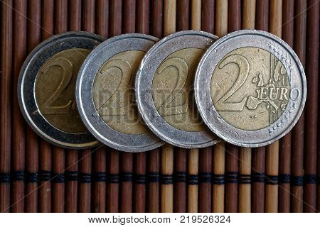 One Euro Coin Lie On Wooden Bamboo Table Denomination Is 2 Euro