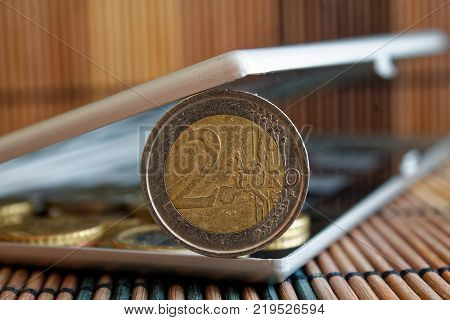Pile Of Euro Coins In Mirror Reflect Wallet Lies On Wooden Bamboo Table ( Wide Angle Background) Den