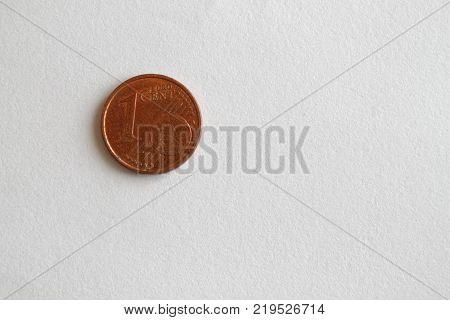 One euro coin lie on isolated white background Denomination is 1 euro cent
