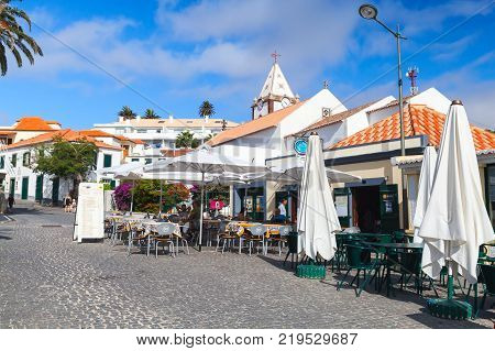 Vila Baleira Portugal - August 18 2017: Street view of Largo do Pelourinho street. Vila Baleira the only city and the capital of Porto Santo Island Madeira ordinary people sit in the restaurant
