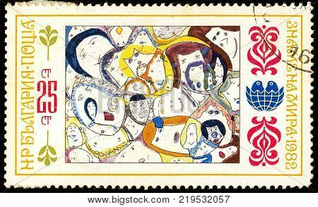 Ukraine - circa 2017: A postage stamp printed in Bulgaria shows children's drawing Women. Series: International Children's Assembly Banner of Peace. Circa 1982.