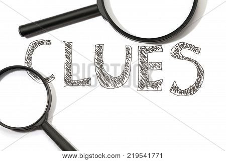 magnifying glass and handwriting word