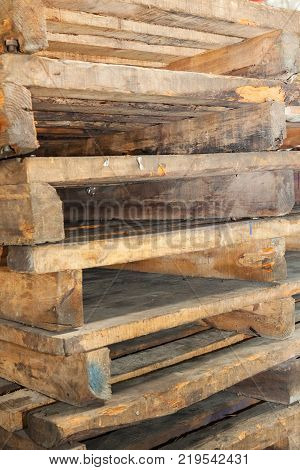 Stacked wooden pallets in outside werehouse ready for use