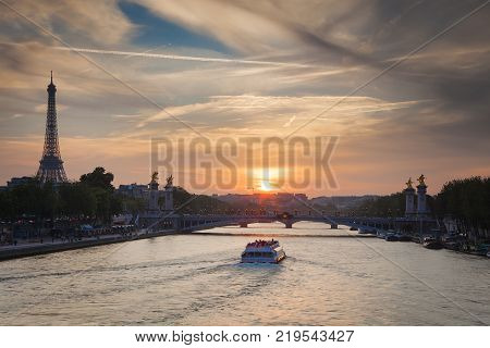 Eiffel Tower and Pont Alexandre III during sunset in Paris. Paris is one of the most visited cities in the world with about 28 million of visitors every year.