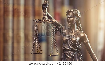 statue of Justice - lady justice or Iustitia / Justitia the Roman goddess of Justice in a courtroom. ideal for websites and magazines layouts