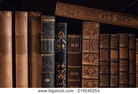 bookshelf at a library with old books. ideal for websites and magazines layouts