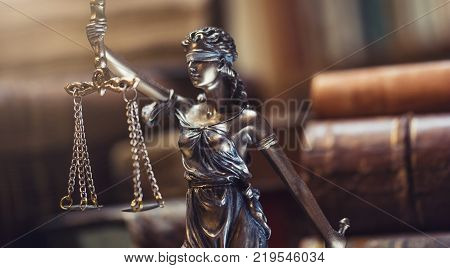 The statue of Justice - lady justice or Iustitia / Justitia the Roman goddess of Justice with old law books. ideal for websites and magazines layouts